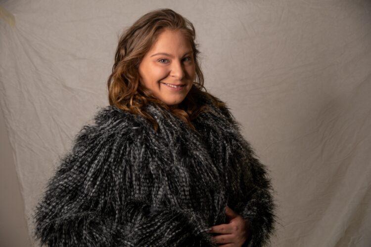 woman in black fur coat