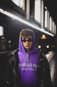 man wearing purple pullover