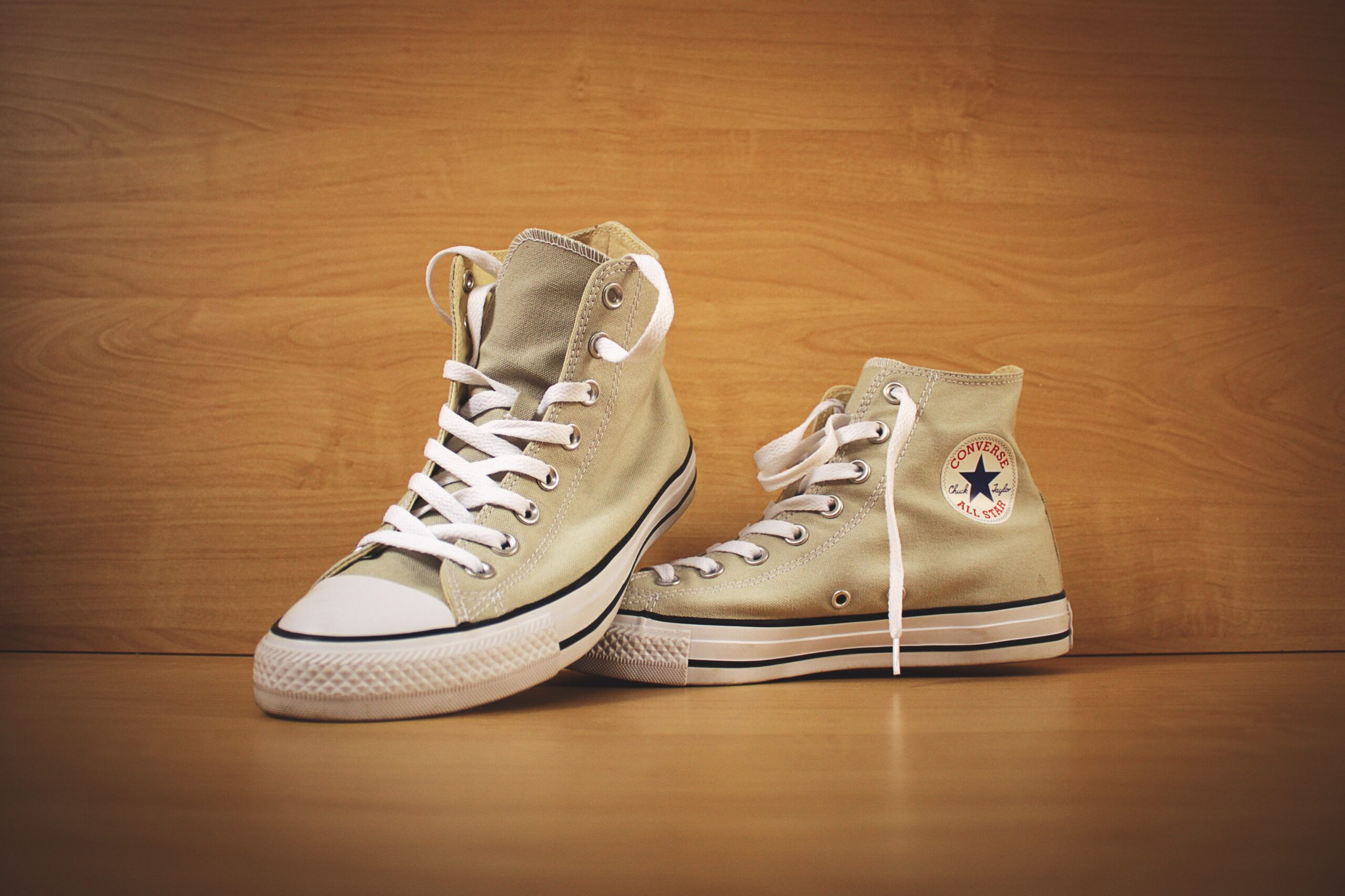 brown Converse high top shoes