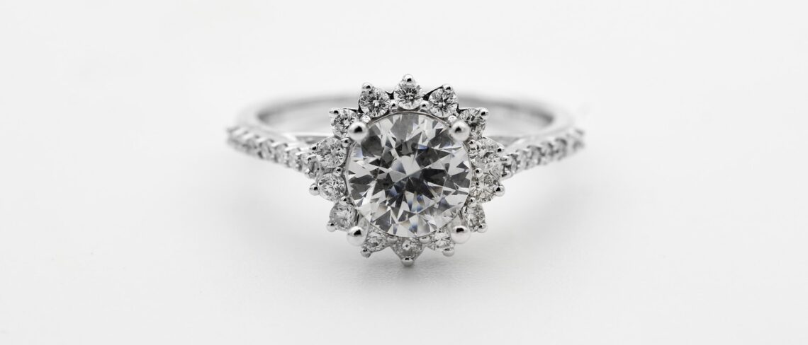 silver diamond studded ring with blue gemstone